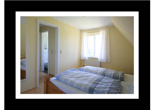Schlafzimmer im Badehus - Ferienwohnungen auf Amrum
